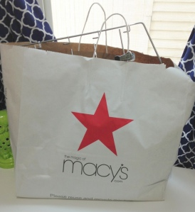The Irony leaving the thrift store with a Macy's bag