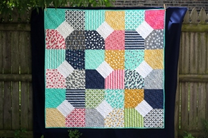 "Title: First Quilt Ever Size: 58"" x 58"" Fabric: V and Co Color Theory Batting: Wool"
